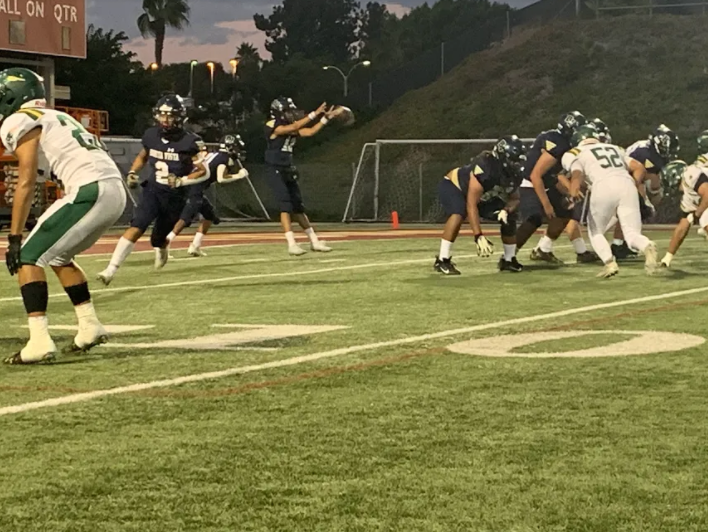 With the snap of the ball the Barons started an offensive play during their homecoming game. The Barons lost with a score of 0-47.